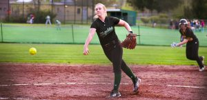 a middleburgh player pitches a ball during a softball game
