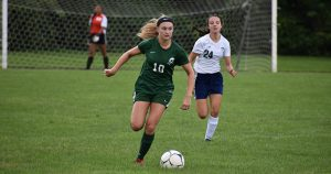 a middleburgh soccer player dribbles the ball