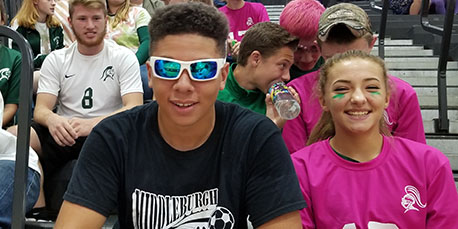 two students pose for a picture at the pep rally