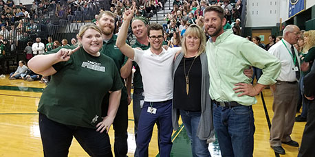 teachers pose for a picture at the pep rally
