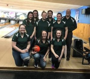the 2018-19 girls bowling team poses for a picture after winning the WAC