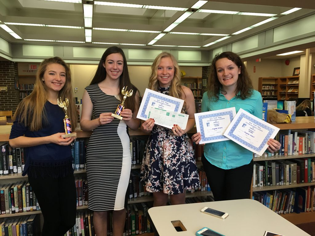 fbla students pose with their awards