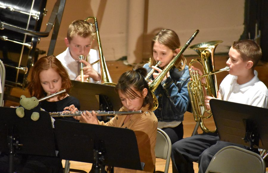 elementary students play insturments during a concert