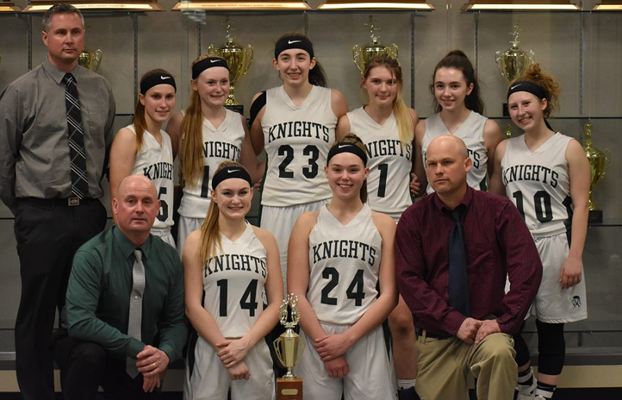 the girls basketball team poses after winning schoburgh
