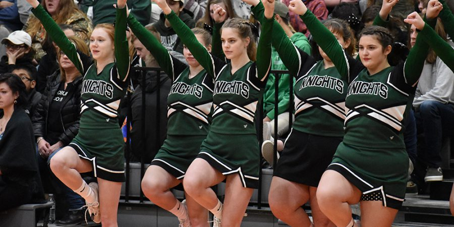 cheerleaders cheer on the basketball team during a game