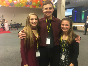 Vivian Hanley, Andrew Miaski, and Andie Burton pose for a picture