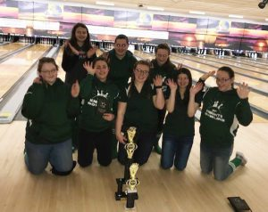 girls varsity bowling poses for a picture after winning the WAC tournament