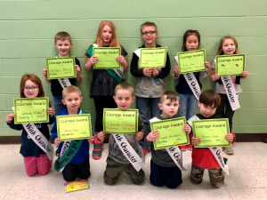 mes students pose with their courage awards