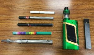 various types of e-cigarettes on a table
