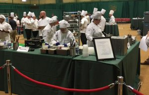 Logan Stephens competes with his teammates on the Capital Region Culinary Team during the state competition.