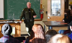 students listen to a presenter during career day