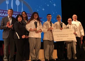 Logan Stephens stands with his teammates on the Capital Region Culinary Team after winning the state competition