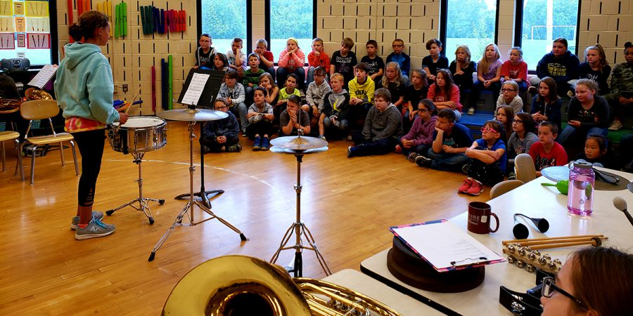 5th and 6th grade students demonstrate band instruments to 3rd grade students during Instrument Demo Days.