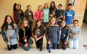 mes students pose with their instruments at nyssma
