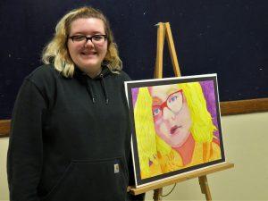Ellise Hunt poses with her artwork.