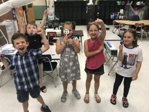 students show off their work during the summer enrichment program