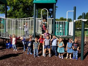 pre-k students pose for a picture