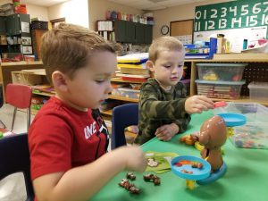 pre-k students play together