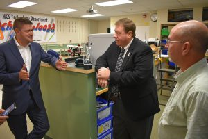 assemblyman chris tague speaks with principal matt sloane and teacher scott gray