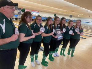 girls bowling poses with their sectional patches