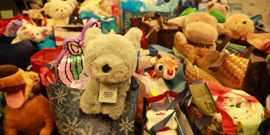 Holiday gift bags of stuffed animals and other toys for Christmas