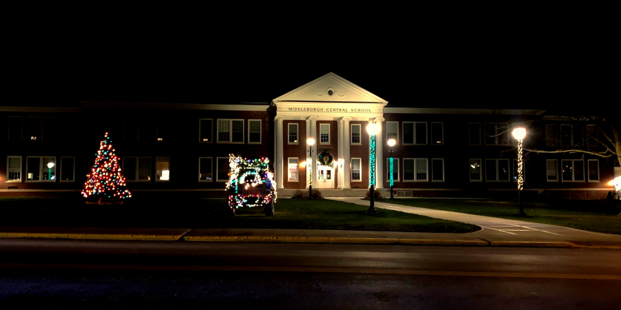 holiday tree and tractor and lampposts decorated in lights