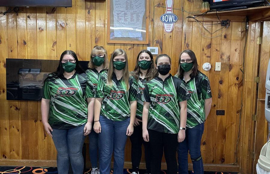 Six members of Middleburgh bowling team in their new jerseys standing side by side