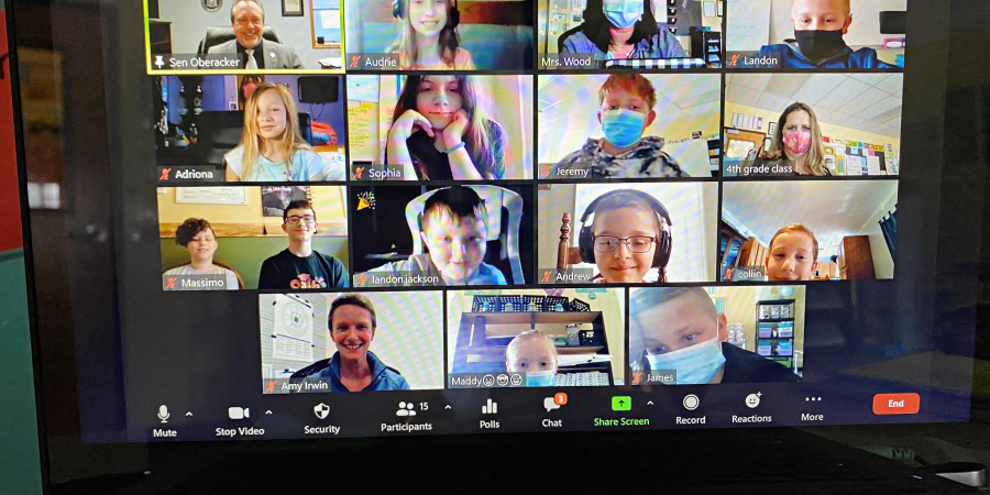 15 students and teachers in Zoom boxes talking to a state senator