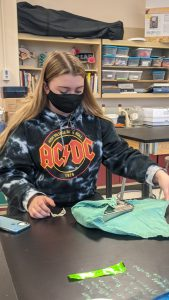 Student practices to wrap and unwrap a surgical pack.