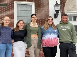 five sophomores stand with arms around each other outside the high school